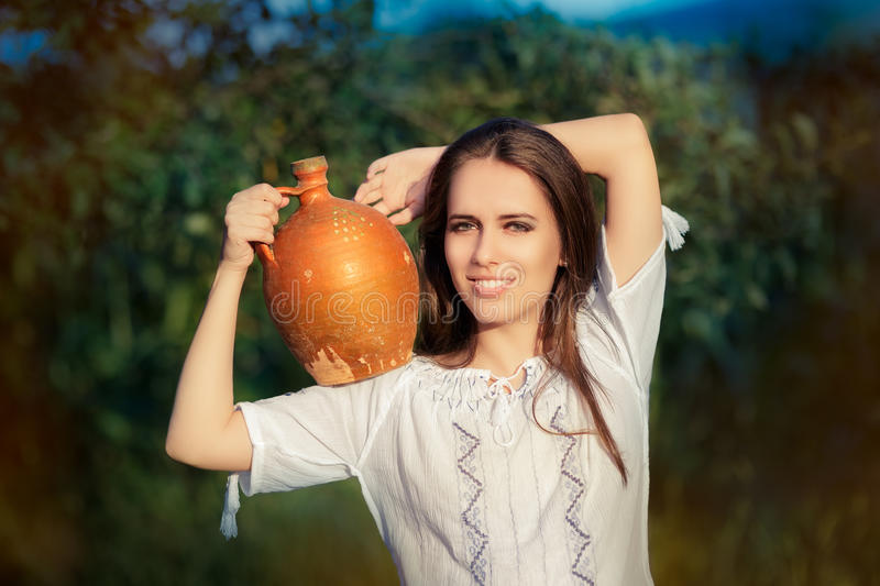 Young Woman with Clay Pitcher royalty free stock photo