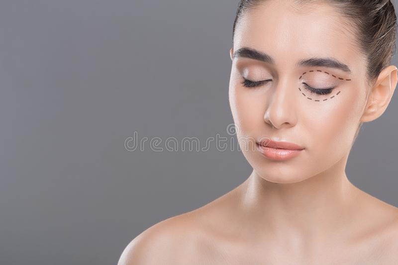 Young woman with clean healthy skin posing with closed eyes. Mua template. Young woman with clean healthy skin posing with closed eyes, free space royalty free stock photography