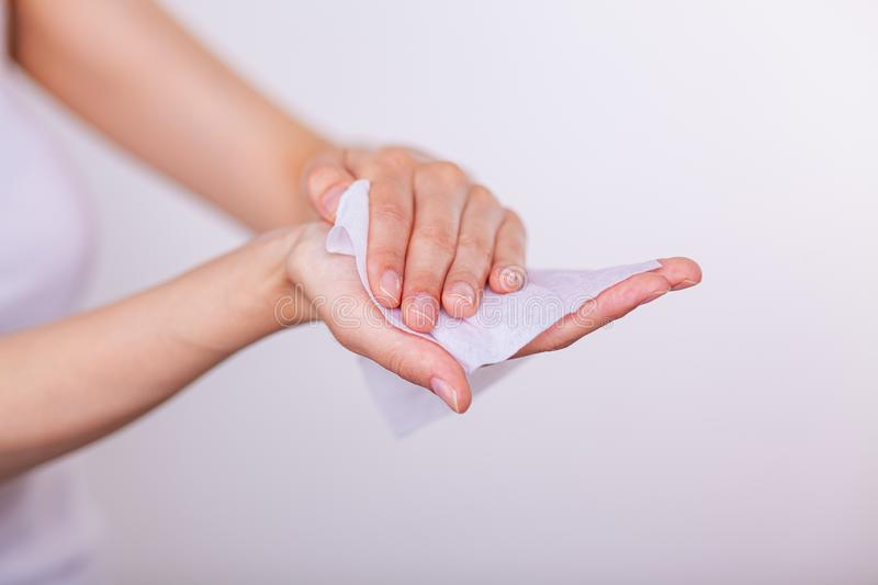 Women cleaning hands with wet wipes, skin care. Young woman cleaning hands with wet wipes, white stock images