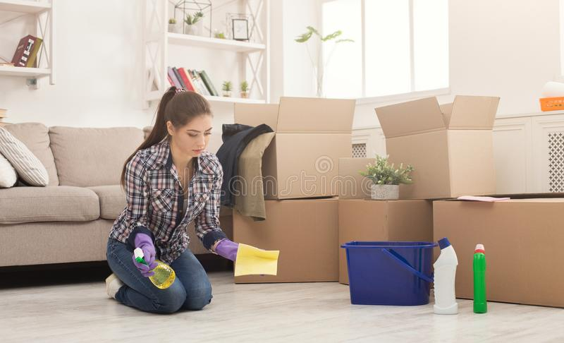 Young woman cleaning home with mop royalty free stock photography
