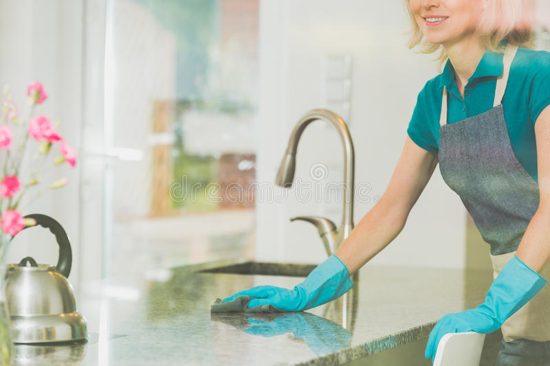 Young woman is cleaning royalty free stock images