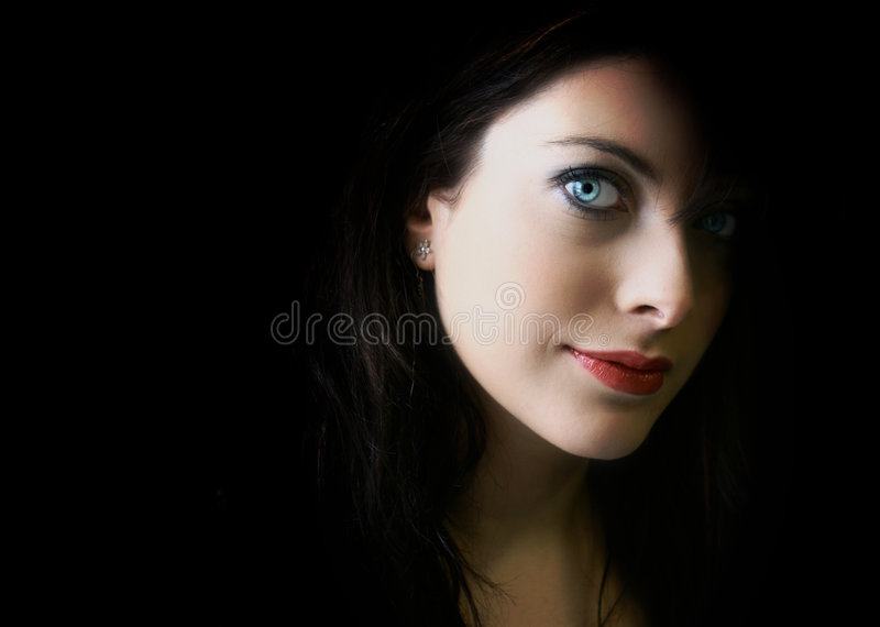 Young woman with clear blue eyes royalty free stock image