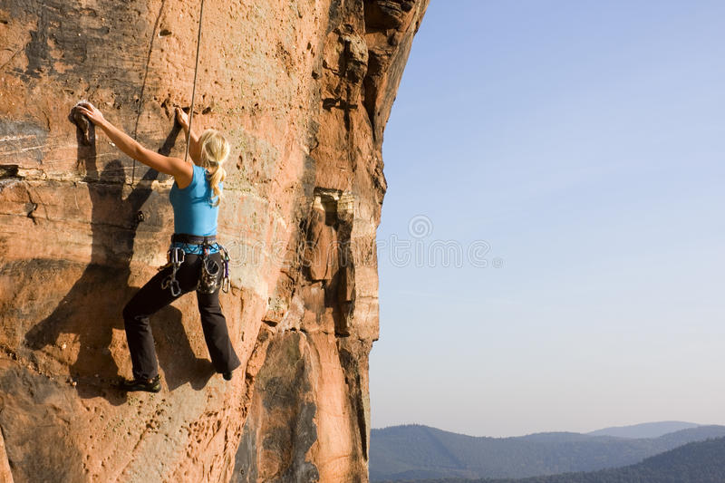Young woman climbing royalty free stock image