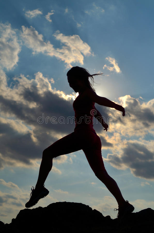 Young woman climbing royalty free stock images