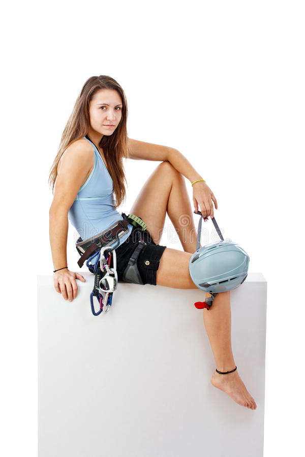 Young woman in climbing equipment stock image