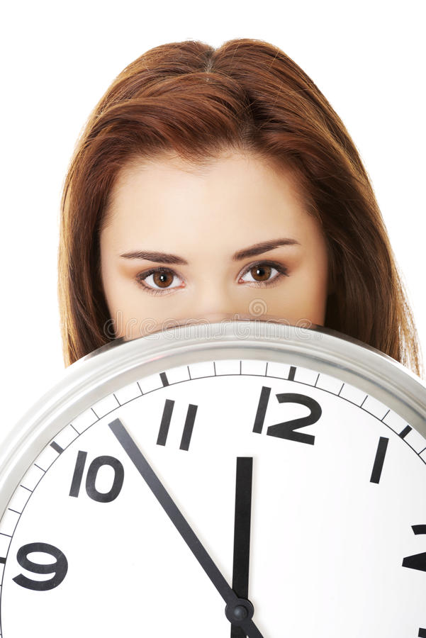 Young woman with clock. Time concept royalty free stock image