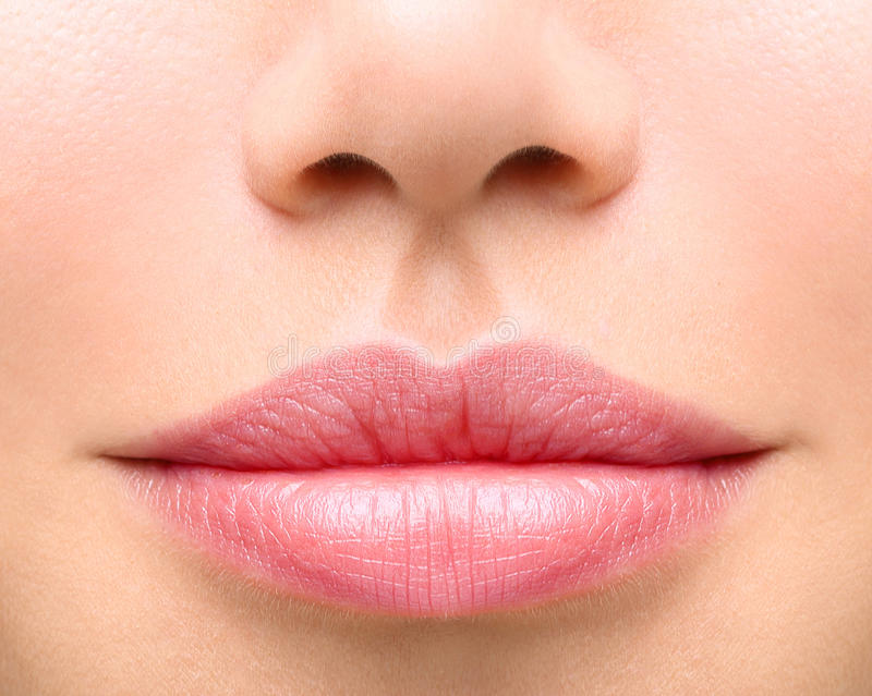 Young woman close up. plump lips stock photography