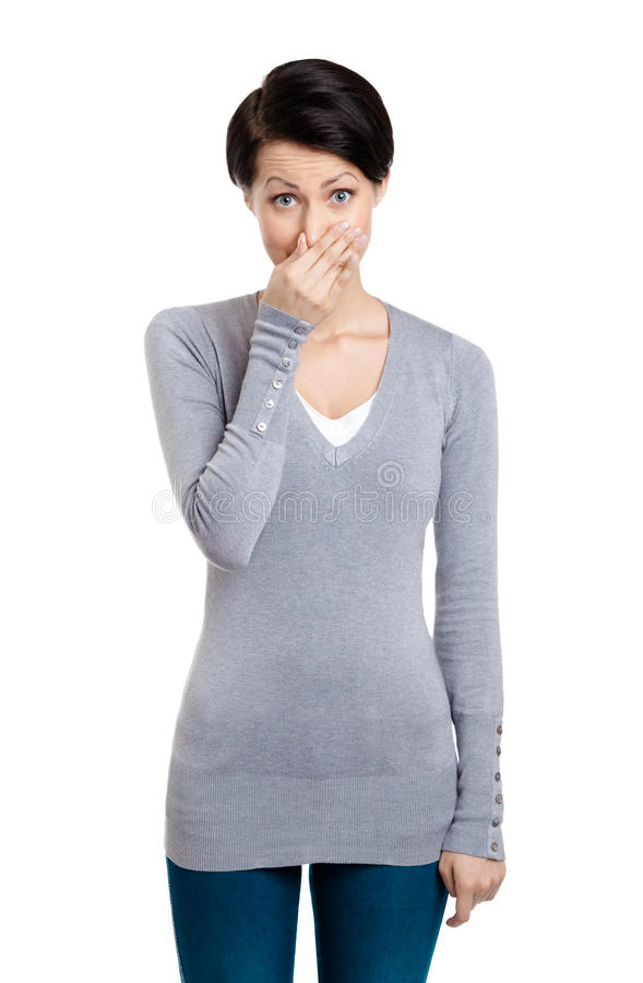 Young woman closes her nose with hand stock photography