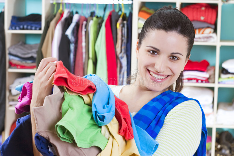 Young woman with clothes stock photos