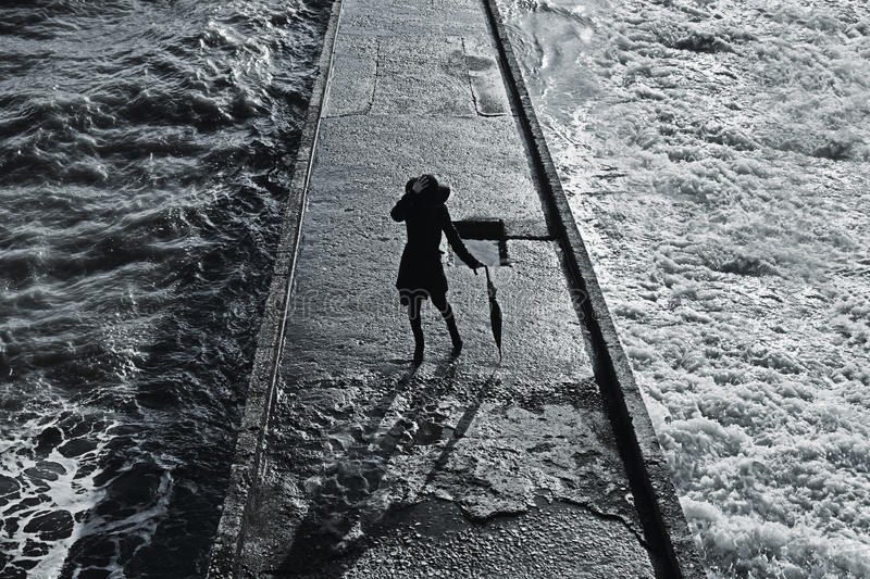 Young Woman In A Coat With An Umbrella On The Pier Stock Images