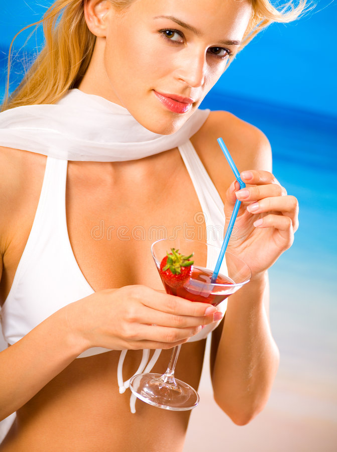 Young woman with cocktail royalty free stock photo