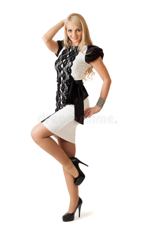 Young woman in cocktail dress. royalty free stock image