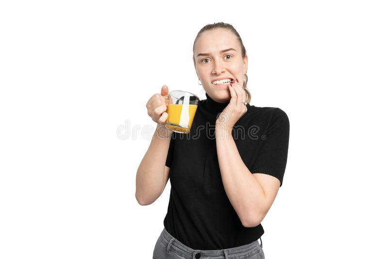 Young woman is cold sensitive when drinking cold drinks. A young woman is cod sensitive when drinking cold drinks royalty free stock photo
