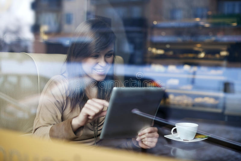 Young woman in coffee shop stock photo