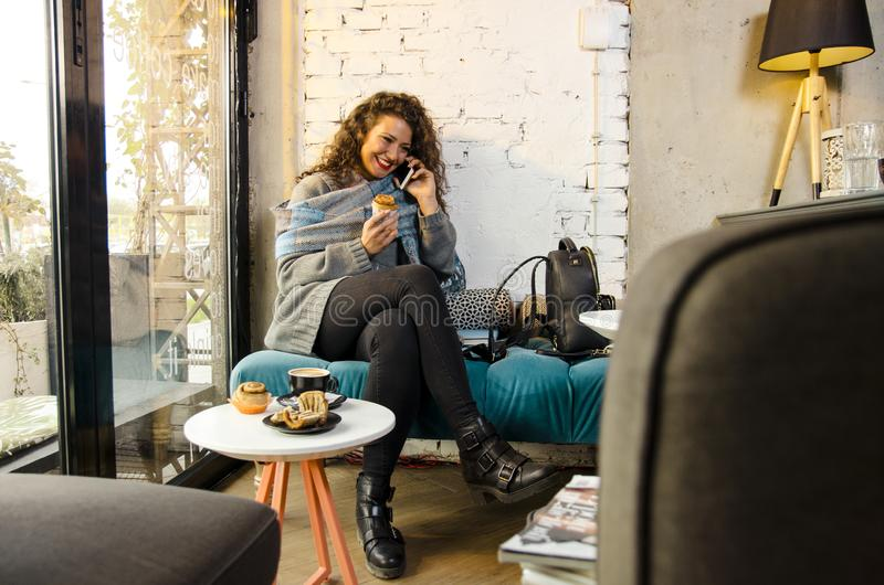 Young woman in coffee shop royalty free stock photos