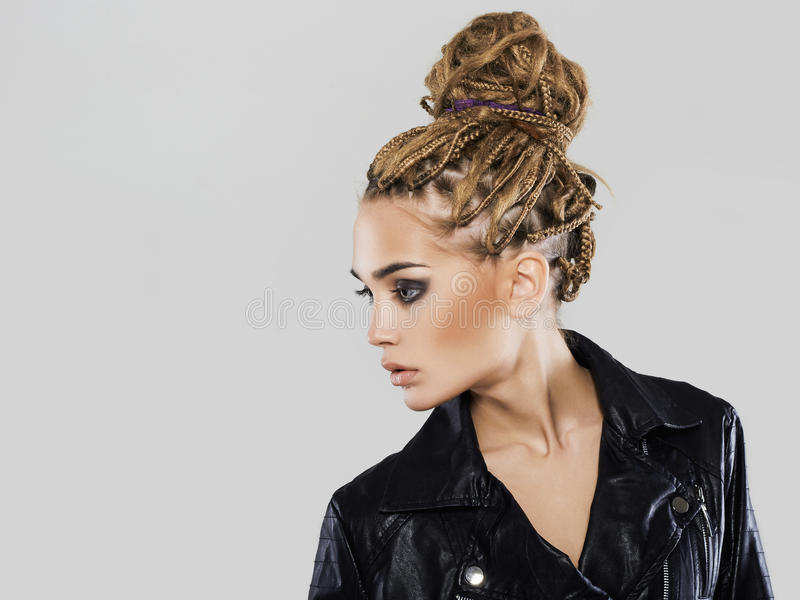 Young woman in Coho jacket.braids hairdo. Beautiful girl with dreadlocks hairstyle. modern young woman in Coho jacket.braids hairdo hipster girl royalty free stock images