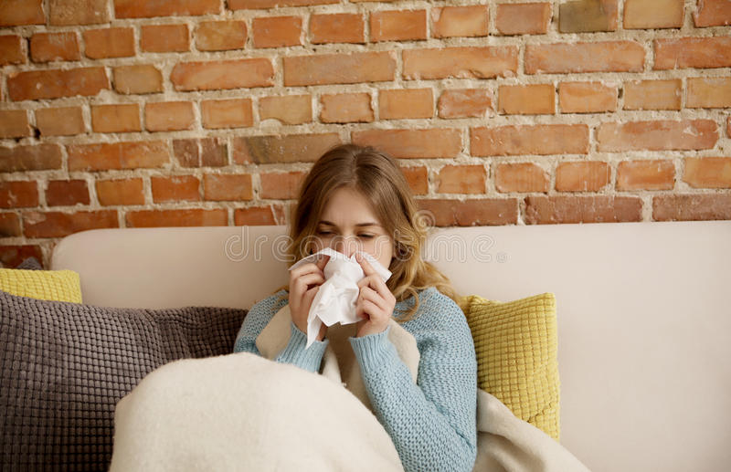 Young woman with cold, flue. royalty free stock photos