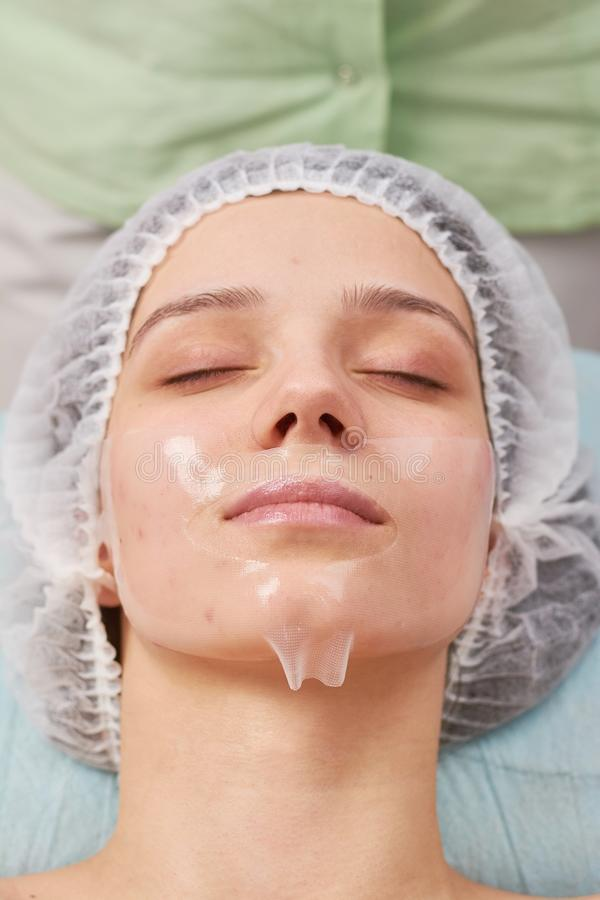 Young woman, collagen mask. royalty free stock image