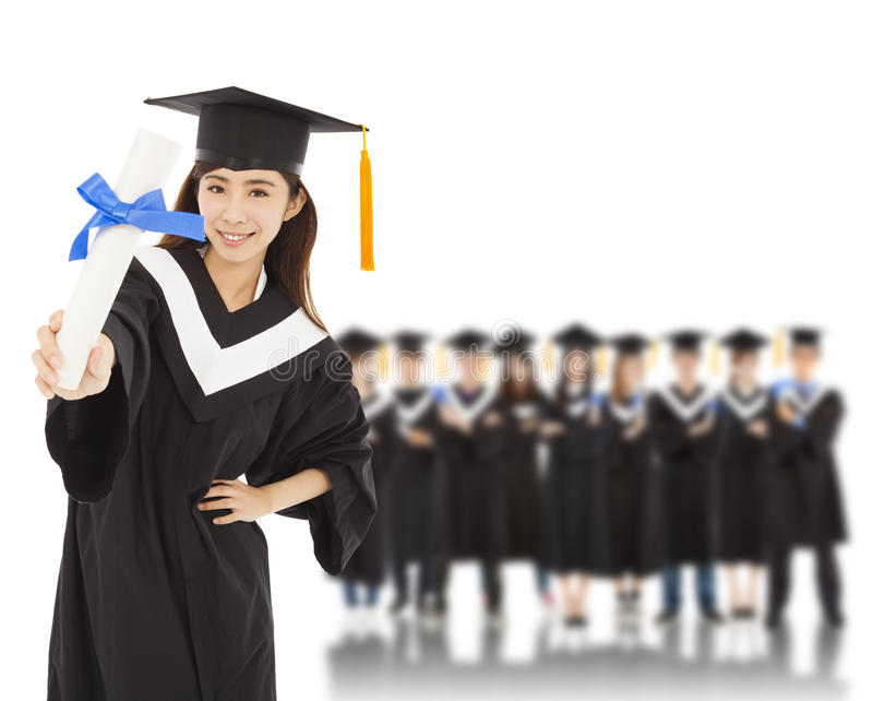 Young woman college graduate with students stock images