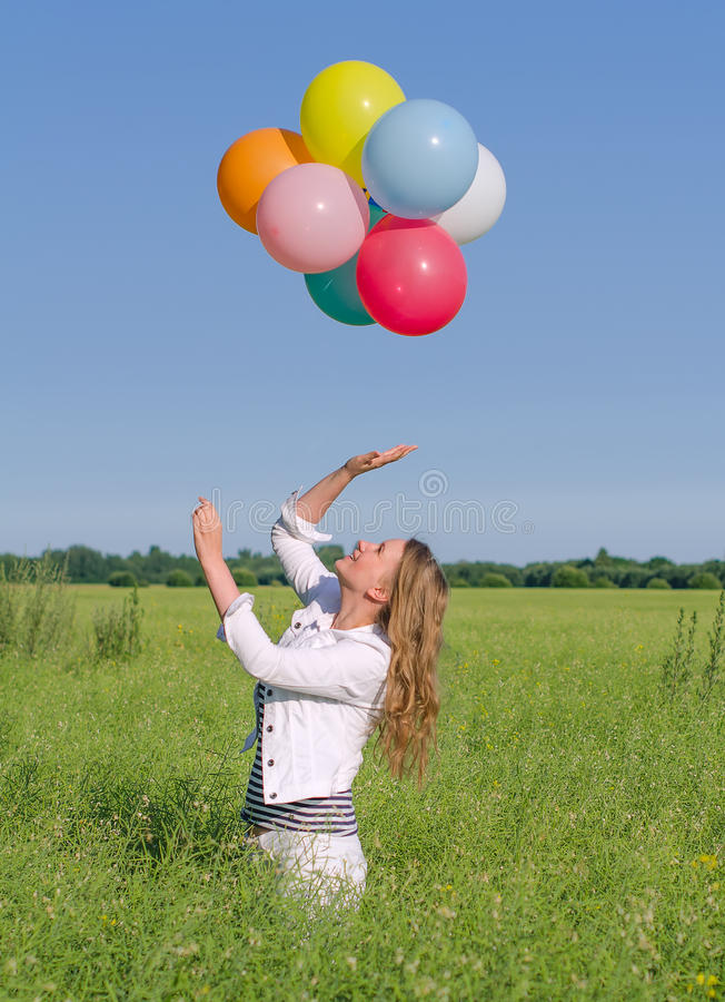 Download Young Woman With Colorful Balloons Stock Image - Image of meadow, person: 32567593