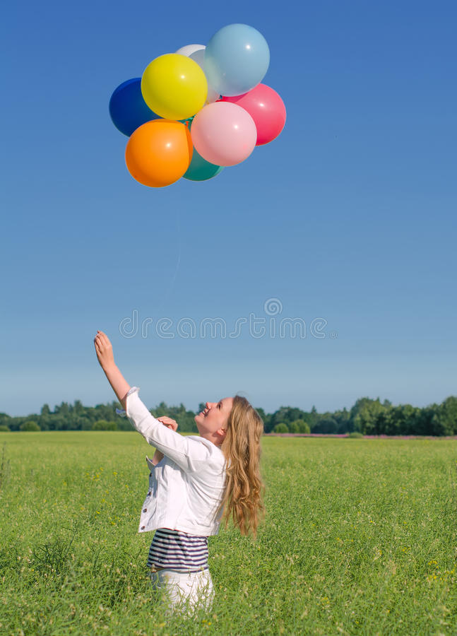 Download Young Woman With Colorful Balloons Stock Image - Image: 32567595