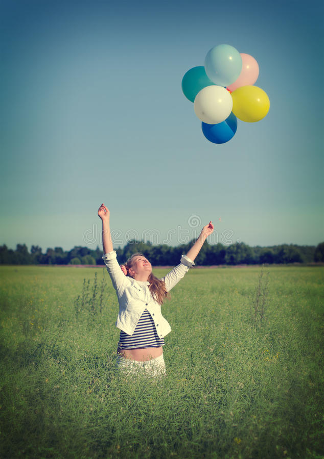 Download Young Woman With Colorful Balloons Stock Image - Image of landscape, lifestyles: 32567599