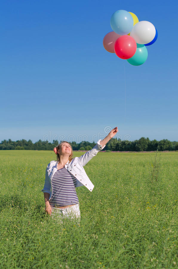 Download Young Woman With Colorful Balloons Stock Images - Image: 32567604