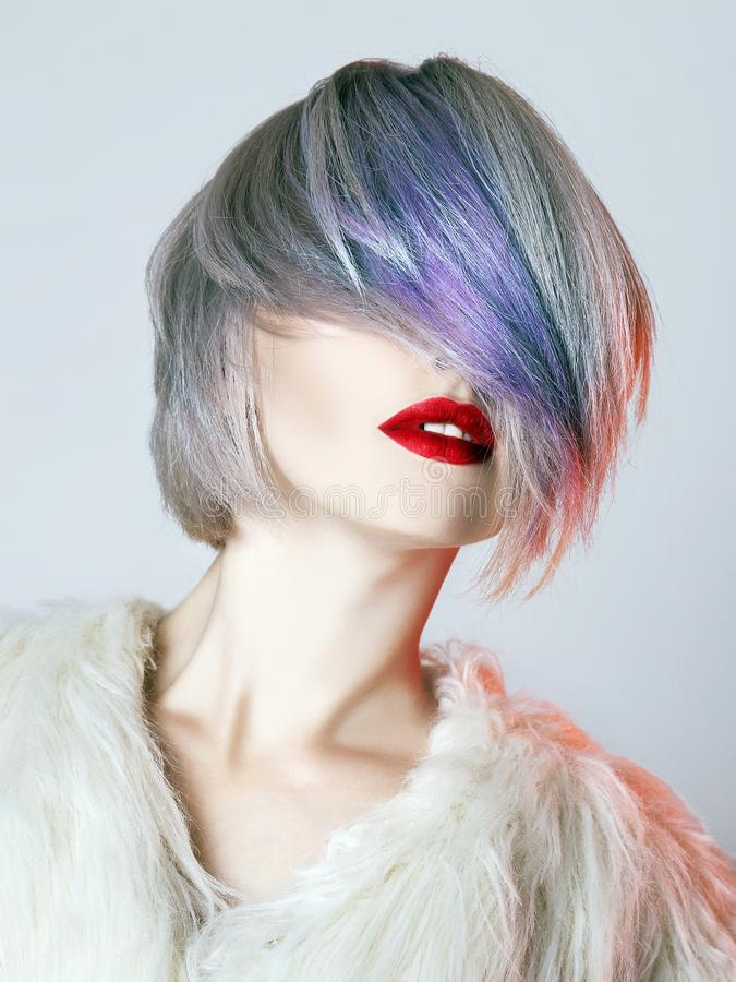 Young Woman with colorful hair, White Fur stock photography