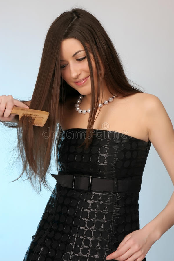 Download Young Woman Combing Her Hair Stock Photo - Image: 10504736