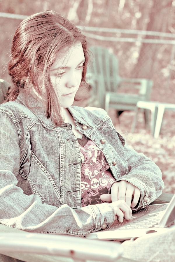 young woman on computer stock photos