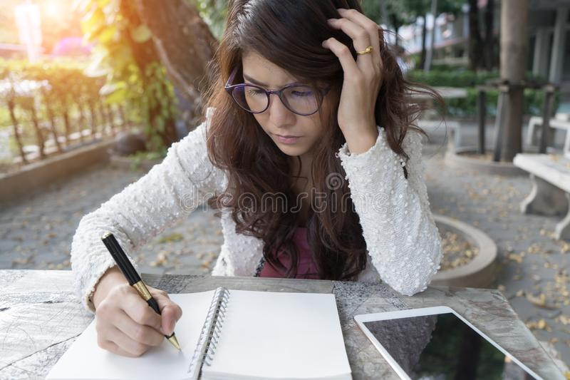 Young woman concentrate reading book. girl learning writing home stock image