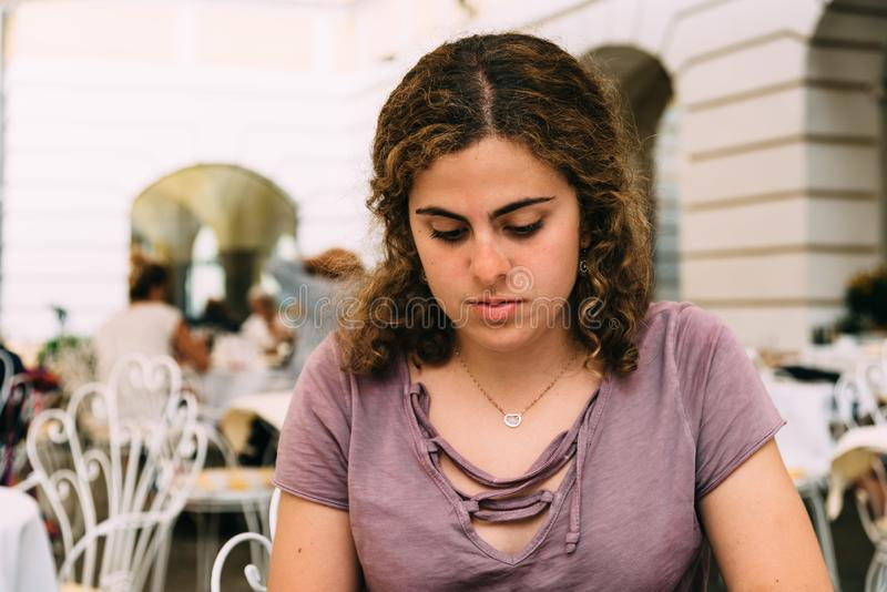 Young woman concentrated waiting for a text royalty free stock photography
