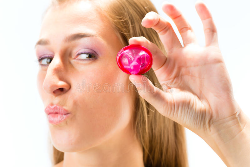 Download Young woman with a condom stock image. Image of infect - 28158219