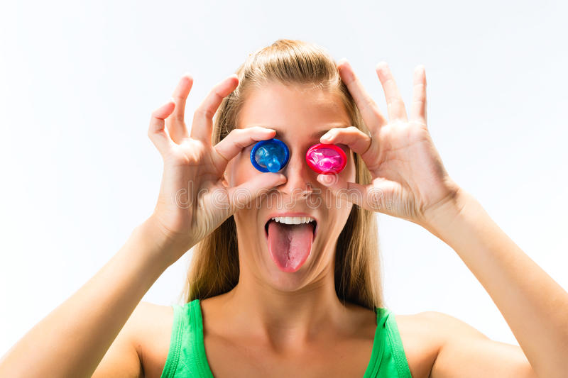 Young Woman With A Condom Stock Photo