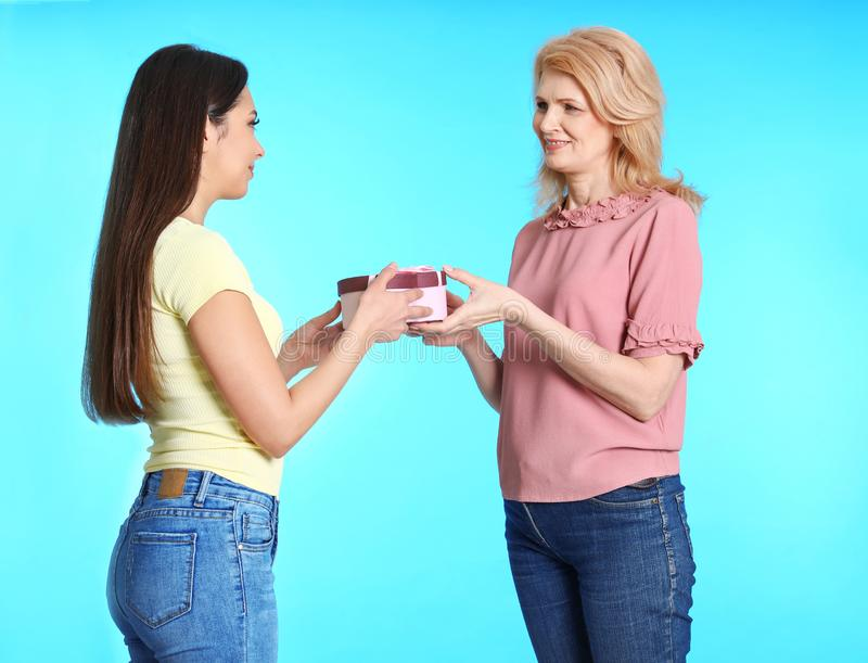 Young woman congratulating her mature mom. Happy Mother`s Day royalty free stock photo