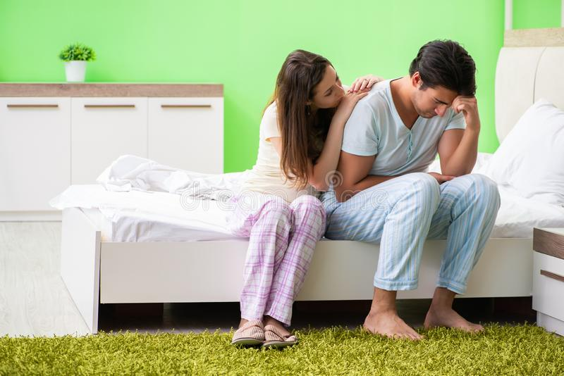 The young woman consoling disappointed impotent husband. Young women consoling disappointed impotent husband stock photo