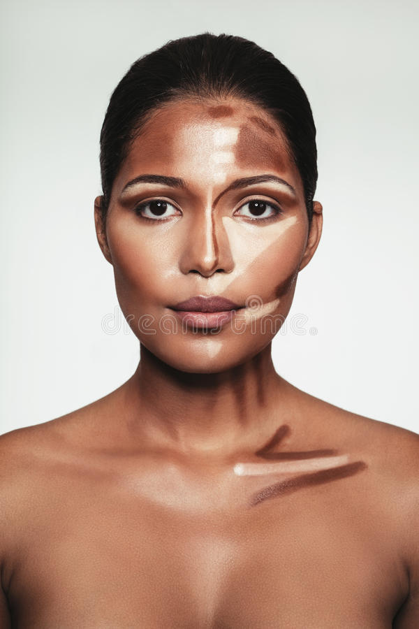Young woman with contour and highlight makeup on face. Close up portrait of young woman with contour and highlight makeup on face against white background royalty free stock photo