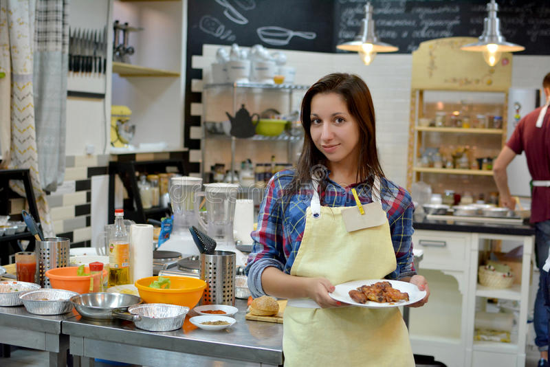 Young woman cook on the kitchen stock photos