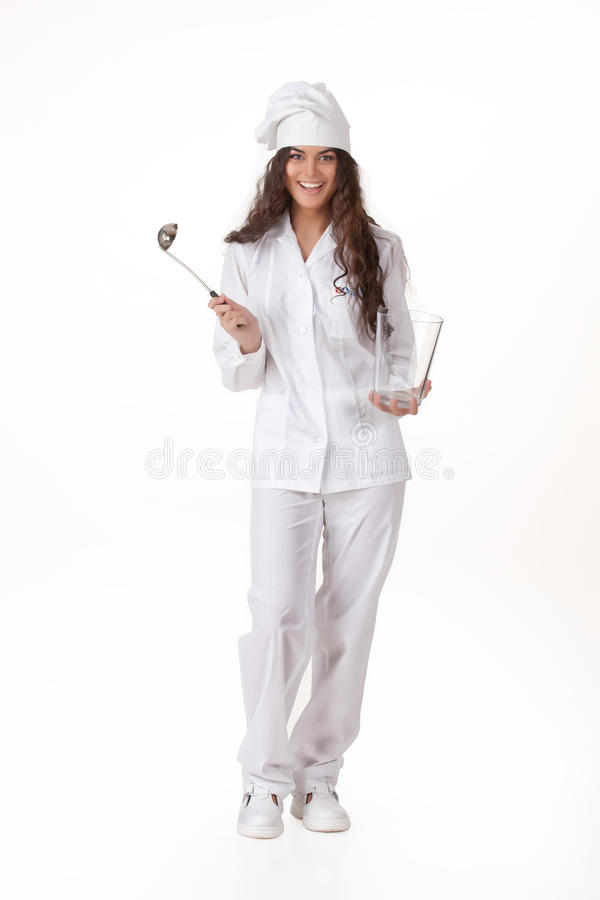 Young Woman In The Cook Uniform. Young attractive woman in the cook uniform with a ladle stock photography