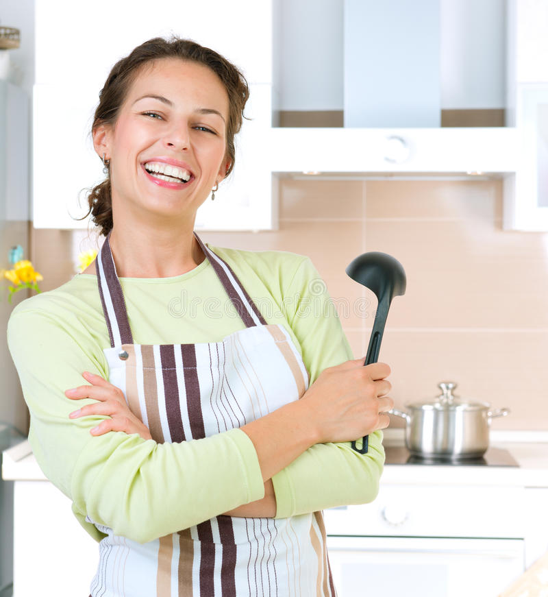 Young woman cooking. Healthy food royalty free stock images
