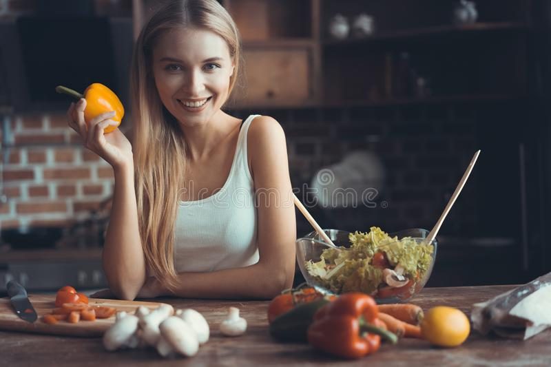 Young Woman Cooking. Healthy Food - Vegetable Salad. Diet. Dieting Concept. Healthy Lifestyle. Cooking At Home. Prepare. Food royalty free stock photos