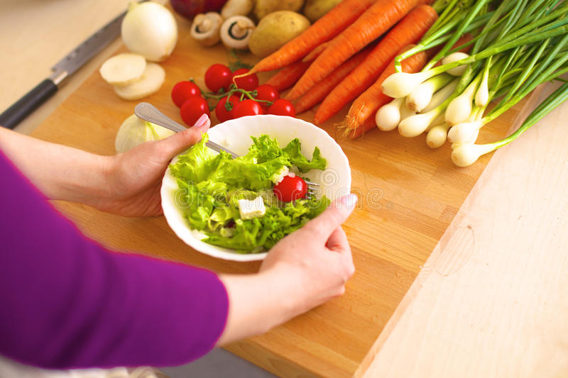 Young Woman Cooking in the kitchen. Healthy Food.  royalty free stock photos