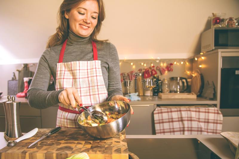 Young Woman Cooking in the kitchen. Healthy Food for Christmas stuffed duck or Goose stock photography