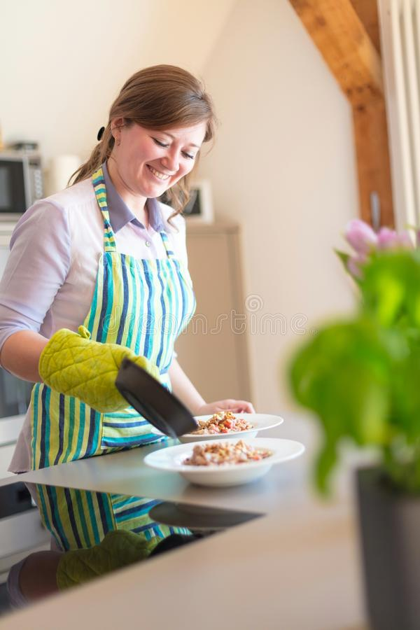 Young Woman Cooking in the kitchen. Healthy Food stock photography