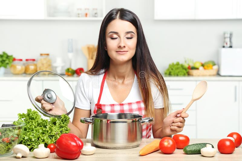 Young woman cooking salad stock photo