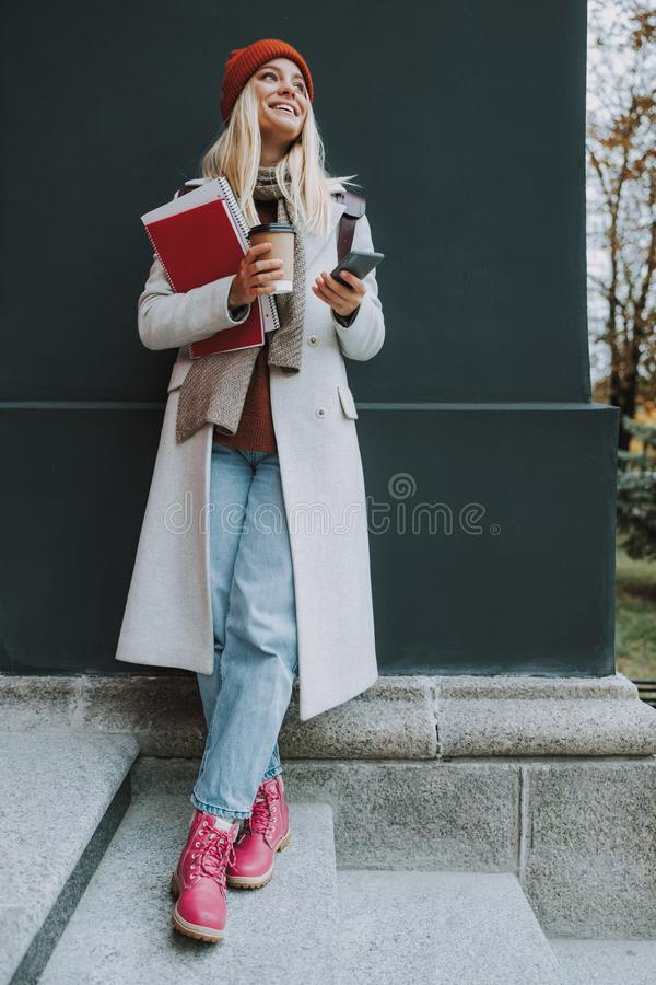 Young woman with copybooks, smartphone and coffee stock photos