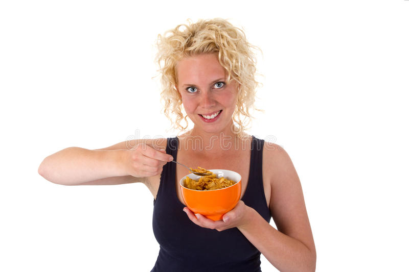 Young woman with cornflakes stock photography