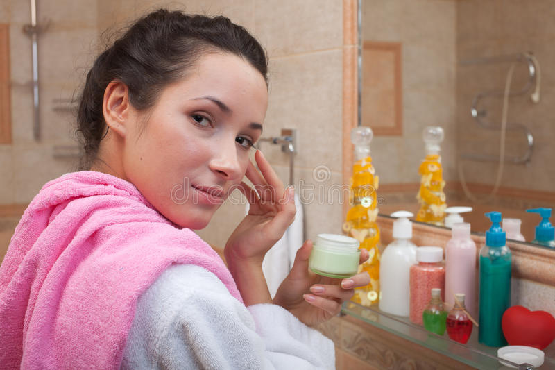 Download Young Woman With Cosmetic Cream Stock Photo - Image of lifestyle, cosmetic: 18447988