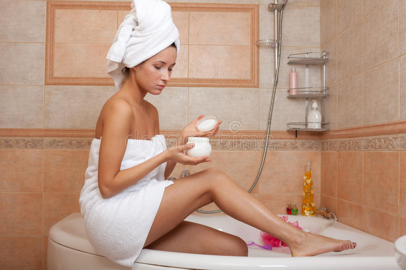Young woman with cosmetic cream stock photo