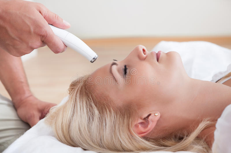 Young Woman During Cosmetic Treatment stock image